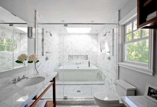 Marble bath inside a shower mosaic brick